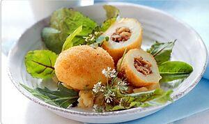Картофель, фаршированный орехами и анчоусами